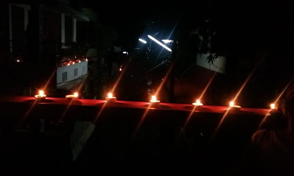 """Lamps lit at a house in Kerala as part of the """"lights out"""" observed for nine minutes by millions across India to express solidarity with each other in the fight against COVID-19, on the night of April 5, 2020."""