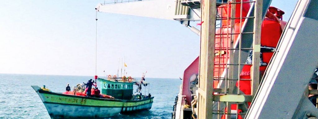 INS Nireekshak, a diving support vessel of Indian Navy, transferring essential supplies and fuel to a stranded fishing boat with 10 fishermen, off Kochi, on April 1, 2020.