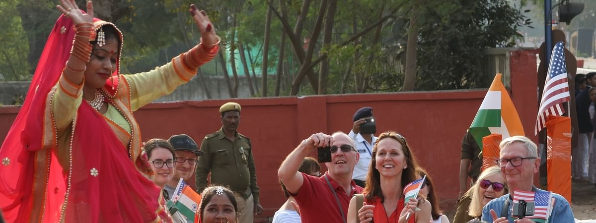 Foreign tourists enjoying a performance by a folk artiste during US President Donald Trump's visit to Agra, on February 24, 2020.