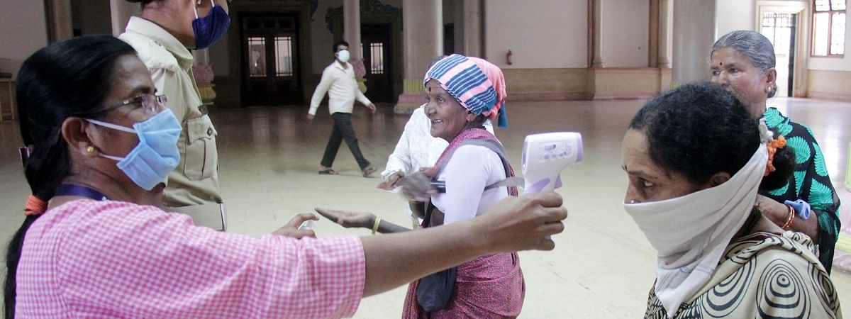 A Government employee undergoing thermal screening for COVID-19 at the Karnataka Secretariat Building in Bengaluru on April 21, 2020.