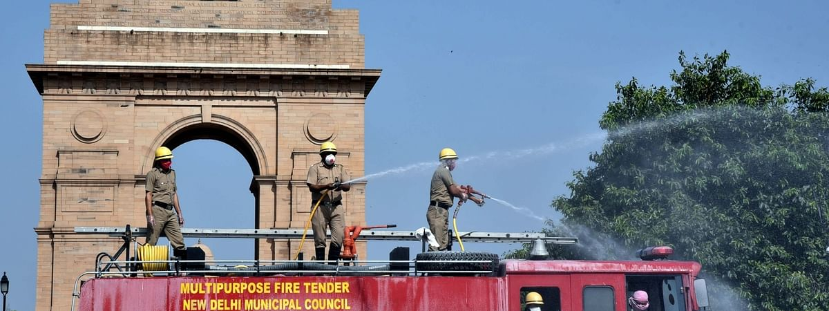 Firefighters spray disinfectants at India Gate in New Delhi as part of a sanitisation drive being conducted across the national capital during the extended nationwide lockdown imposed to contain the spread of the coronavirus, on April 17, 2020.
