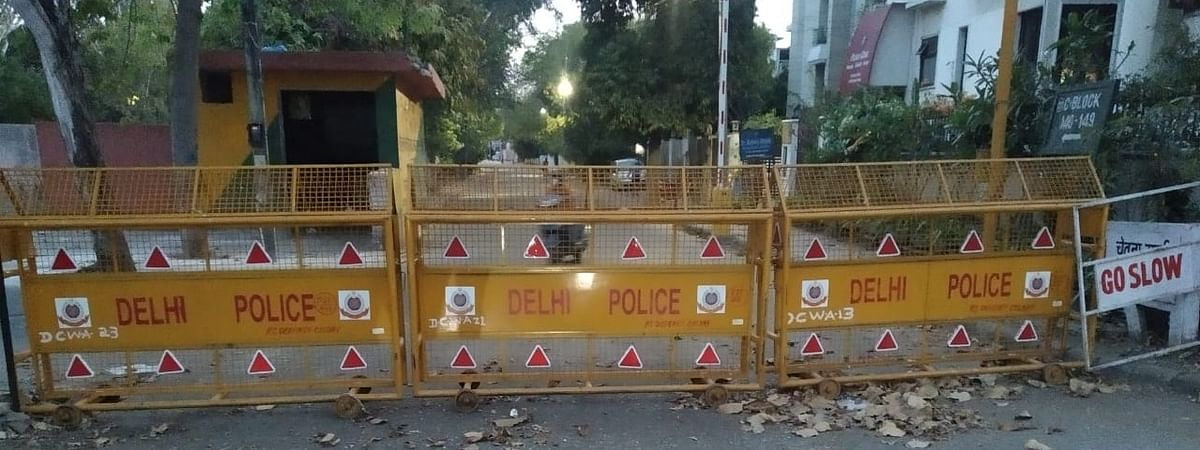A South Delhi residential area turned into a fortress after three cases of coronavirus are found in the area, on April 9, 2020.