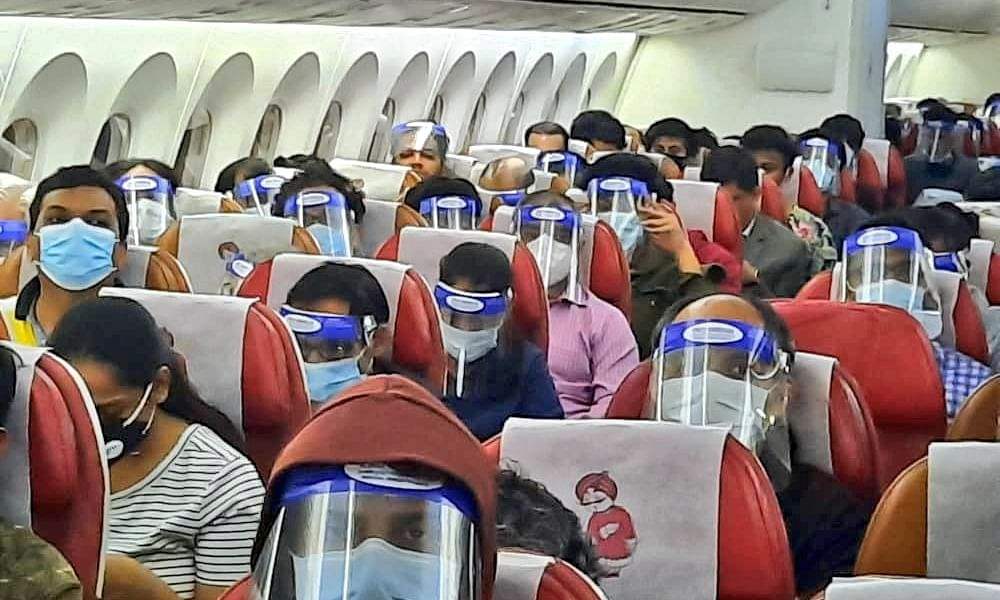 Indians flying back from Kuala Lumpur, Malaysia on Air India flight AI 1377 on May 12, 2020 as part of the Vande Bharat Mission to bring back stranded Indian nationals from foreign countries during the lockdown imposed to contain the spread of the coronavirus (COVID-19) pandemic.