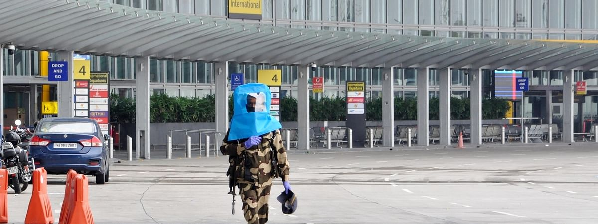 A Central Industrial Security Force (CISF) personnel wearing a COVID-19 protective face shield, deployed at the Netaji Subhash Chandra Bose International Airport in Kolkata on May 28, 2020.