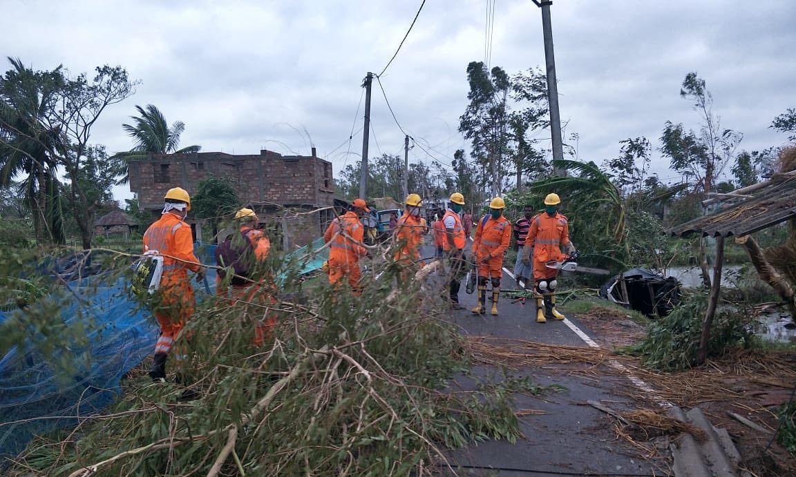 NDRF personnel carrying out restoration works at Gosaba in South 24 Parganas district of West Bengal after the state was hit by Cyclone Amphan on May 20, 2020.