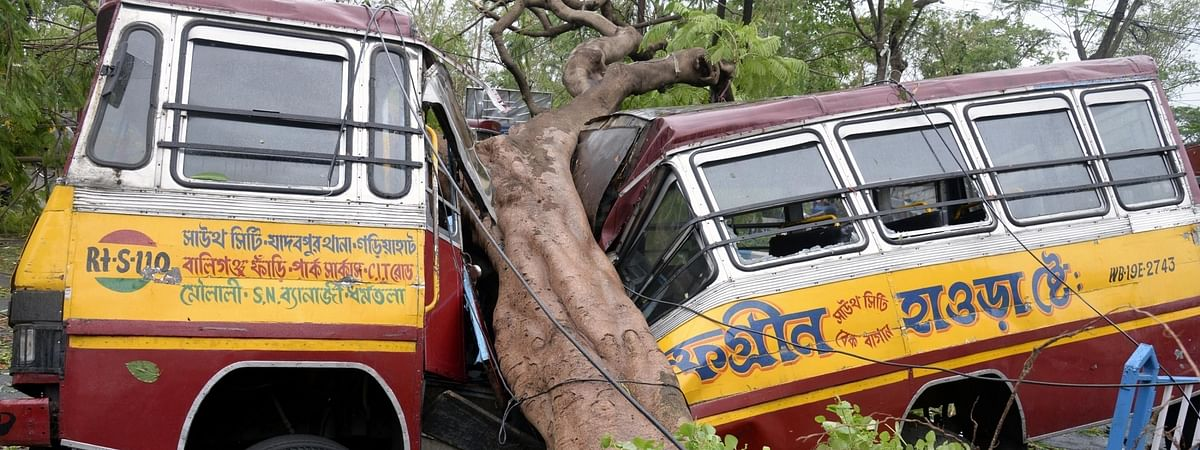 An uprooted tree left a bus damaged and the road blocked after cyclone Amphan hit Kolkata and other parts of West Bengal on May 20, 2020.