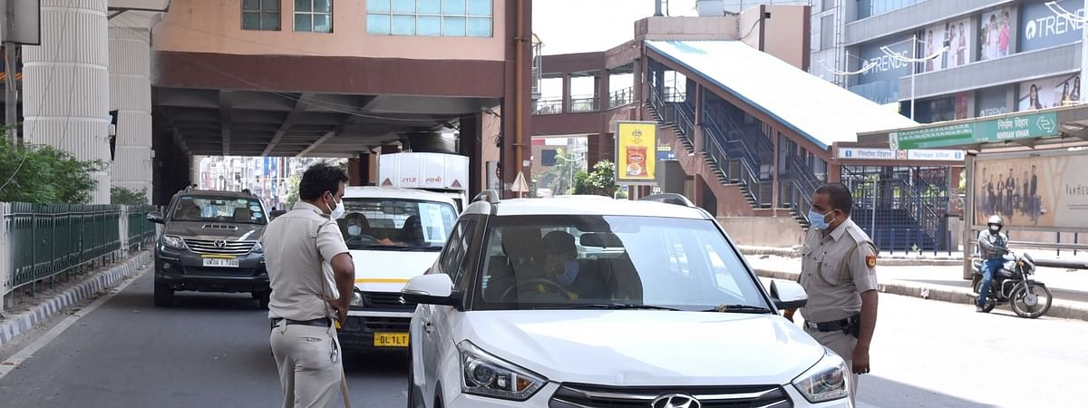 Police checking vehicles near the Nirman Vihar metro station on Vikas Marg during the extended nationwide lockdown imposed to contain the spread of the coronavirus (COVID-19) pandemic, in New Delhi on May 2, 2020.