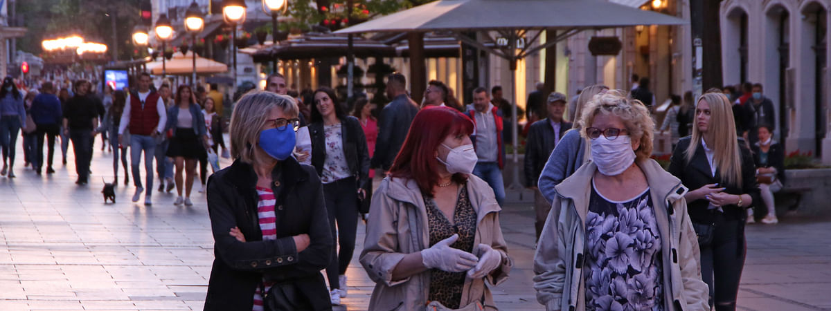 People strolling along a main street in Belgrade, Serbia, on May 8, 2020. The Serbian National Assembly adopted government proposal to abolish the state of emergency over COVID-19 on Wednesday because the ratio of infected among tested people dropped to below 5 percent.