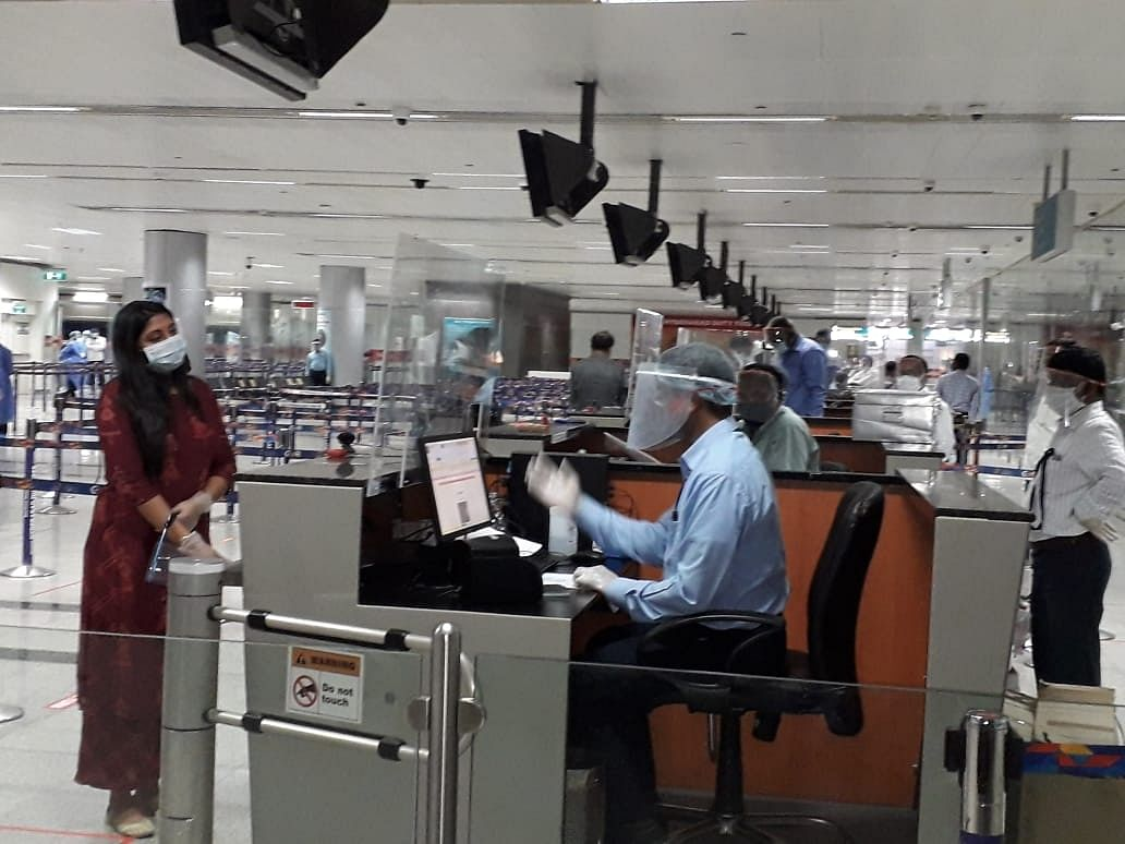 Indians stranded in Kuwait who arrived by a special Air India flight, at the Rajiv Gandhi International Airport in Hyderabad, on May 9, 2020.