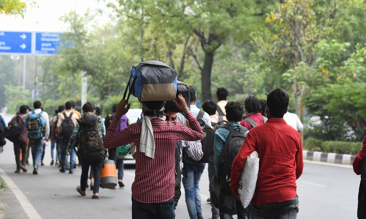 Migrant labourers from Uttar Pradesh walking on foot in a bid to reach their home towns, in Delhi during the nationwide lockdown imposed to mitigate the spread of coronavirus, on May 14, 2020.