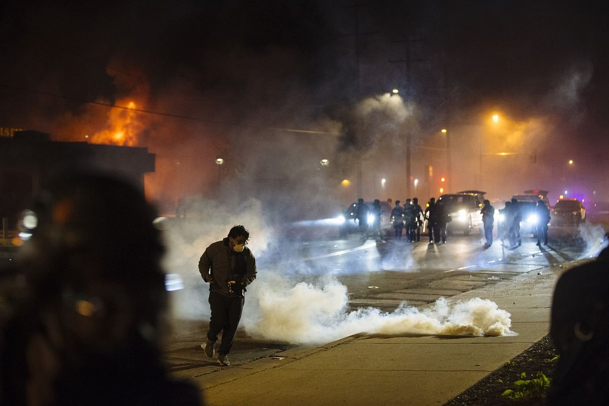 A protester running from tear gas fired by the riot police in Minneapolis, the United States, on May 29, 2020.