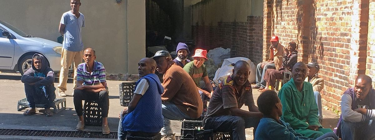 People sitting together on a street in Johannesburg, South Africa on April 17, 2020.
