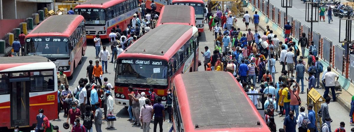 Migrant workers from different parts of the country who were stuck in Karnataka due to the nationwide lockdown imposed to contain the spread of coronavirus, gather at Bengaluru's Majestic Bus Stand to take buses to their hometowns, on May 3, 2020.