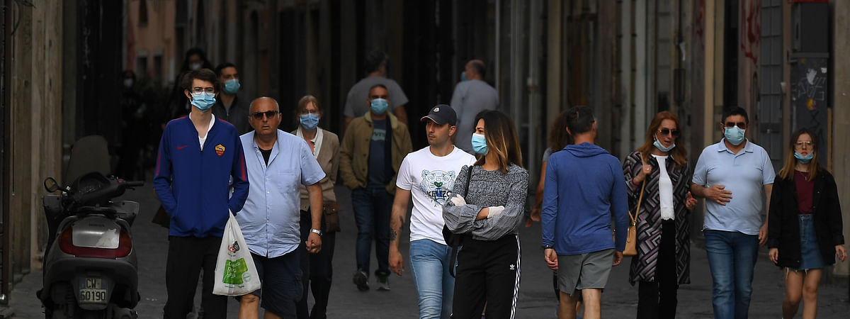 People walking along a street in Rome, Italy, on May 8, 2020.