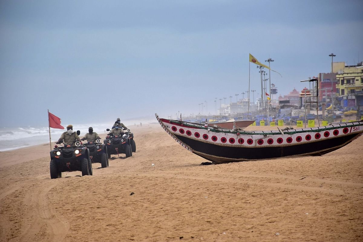 Marine police team patrolling the beach to alert fishermen about cyclone Amphan, in Puri, Odisha on May 18, 2020.