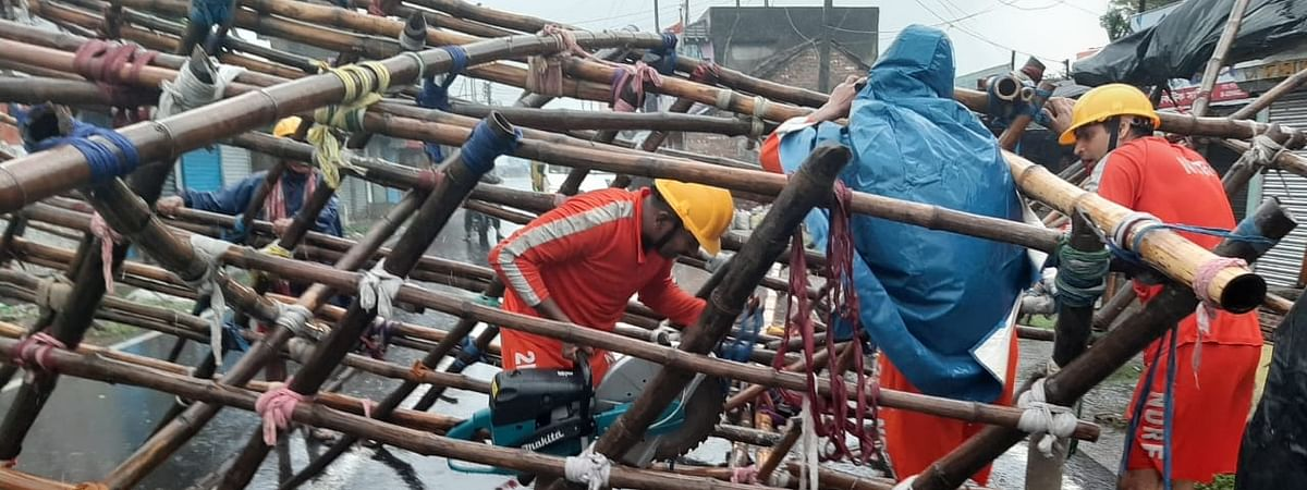 NDRF teams engaged in road clearance work with cutting equipments at Shyampur Block in Howrah district after severe cyclonic storm Amphan made a landfall in West Bengal on the afternoon of May 20, 2020.