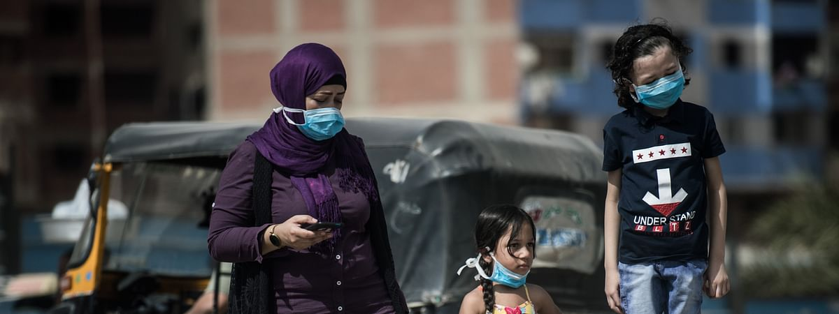 People wearing face masks seen on a street in Cairo, Egypt, on May 3, 2020.