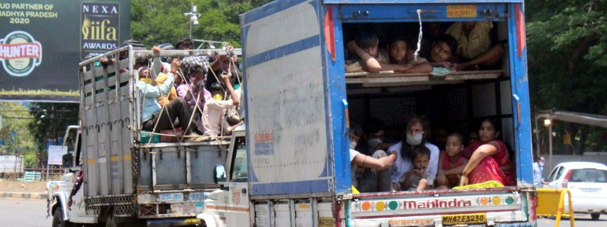 Stranded migrant labourers travelling in mini-trucks to their native places in Uttar Pradesh from Bakania Bypass in Bhopal, Madhya Pradesh during the nationwide lockdown imposed to contain the spread of coronavirus, on May 11, 2020.