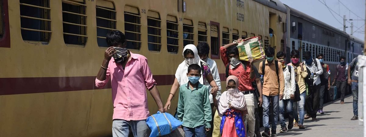 Bihar migrants who were stuck in Karnataka due to the ongoing nationwide lockdown imposed to mitigate the spread of coronavirus, arriving at Patna's Danapur railway station after returning from Bengaluru on a Shramik Special train, on May 6, 2020.