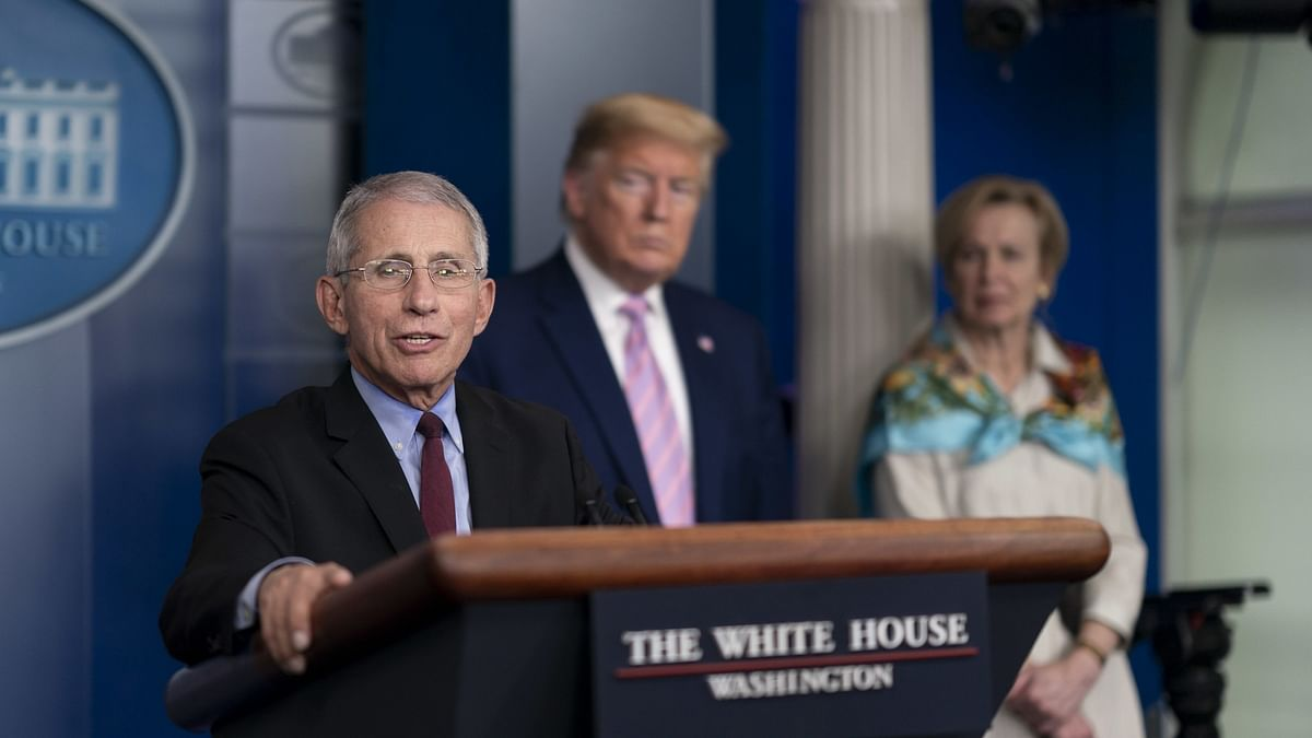 As COVID-19 patient Trump rips off mask, Fauci urges Americans to put it on