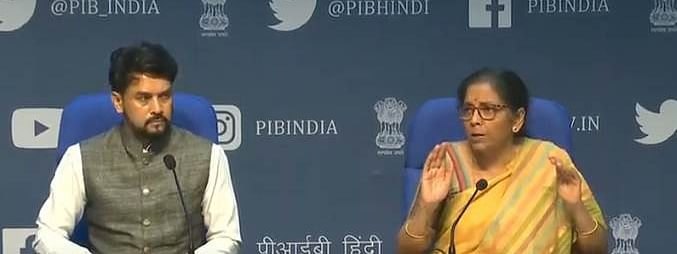 Finance Minister Nirmala Sitharaman addressing a press conference in New Delhi on May 14, 2020. Minister of State for Finance Anurag Thakur can also be seen.