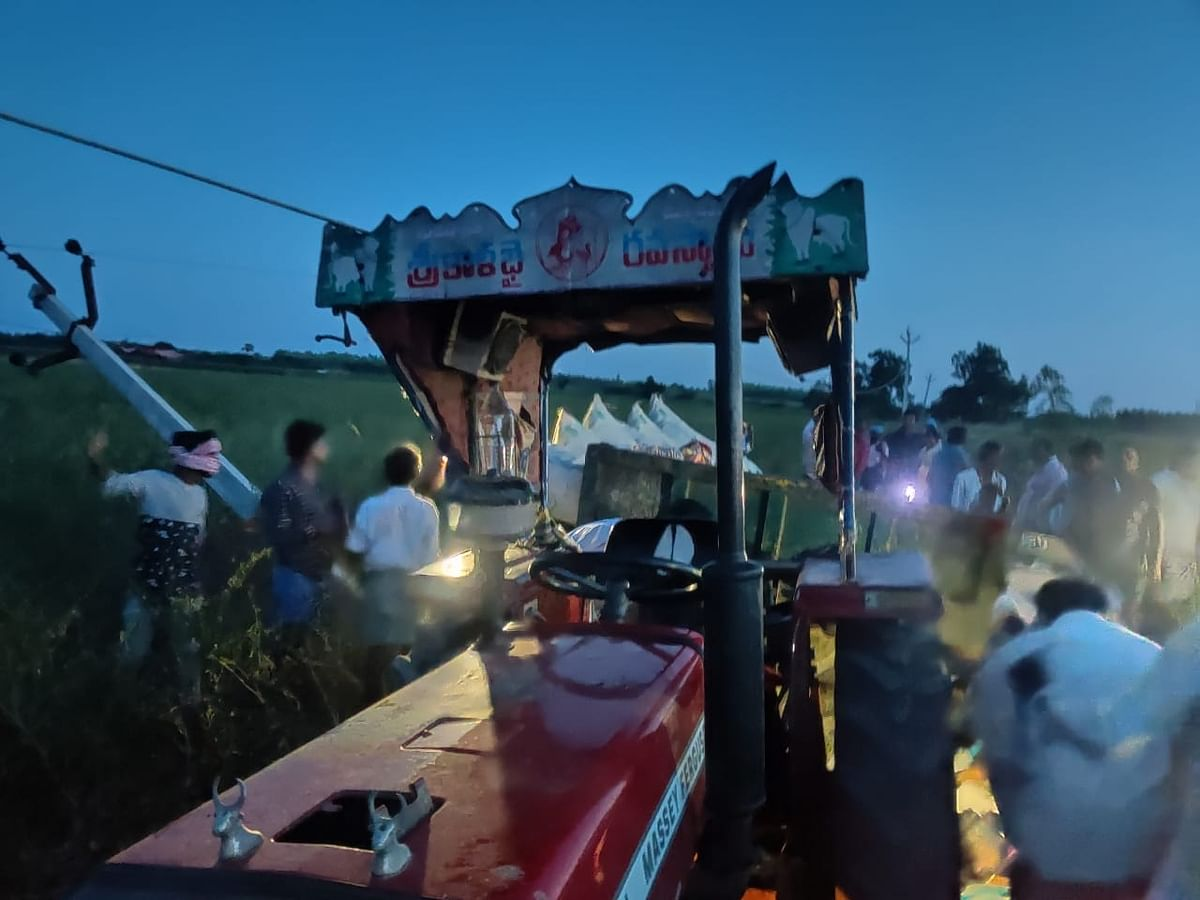 Locals gathered at the  site where ten people, including seven women, were electrocuted to death and two others injured after a live wire fell on them when the tractor-trolley they were travellig in hit an electricity pole near Machavaram village in Prakasam district of Andhra Pradesh on May 14, 2020.