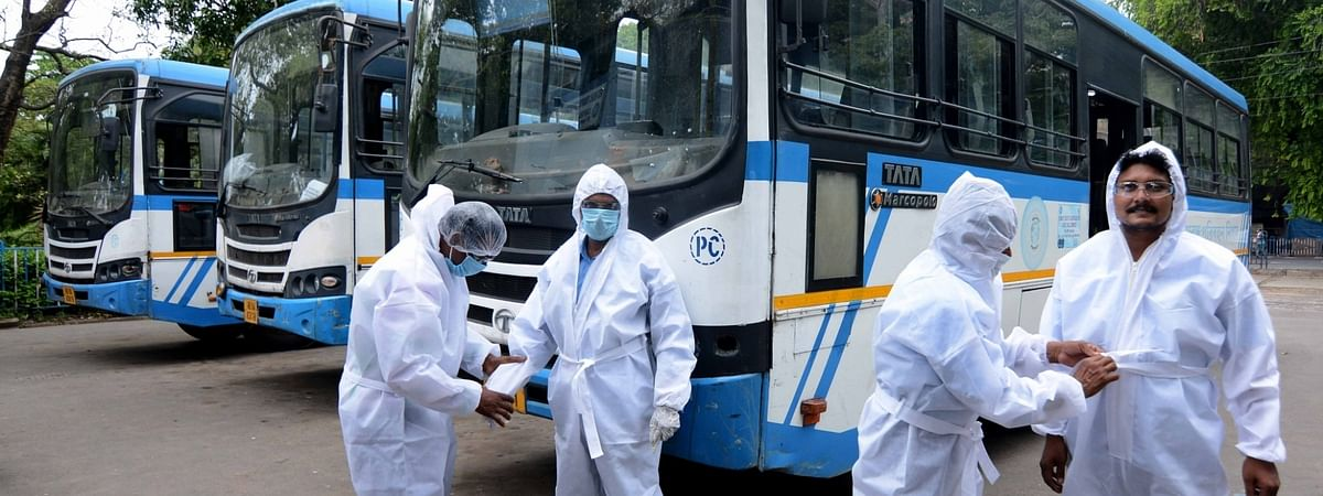 Drivers of West Bengal Transport Corporation (WBTC) buses wear Personal Protective Equipment (PPE) suits ahead of resuming their duties, on the second day of the fourth phase of the nationwde lockdown imposed to contain the spread of the coronavirus pandemic, in Kolkata on May 19, 2020.