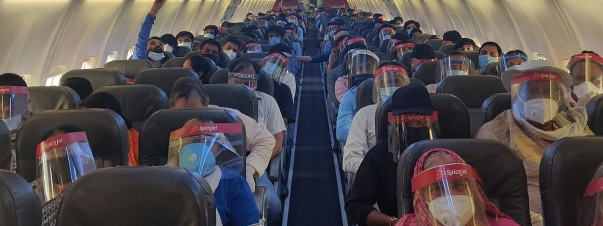 Passengers on a SpiceJet flight from Delhi to Patna on May 26, 2020