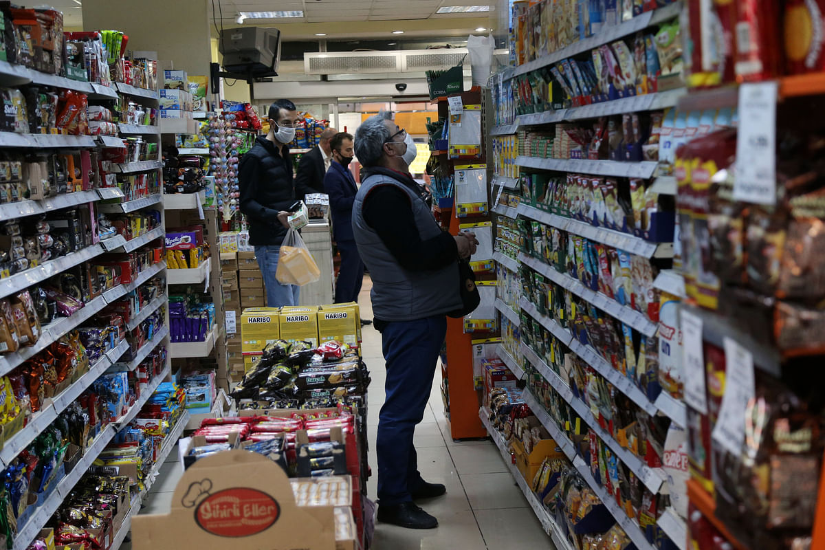 People wearing masks shopping at a convenience store in Ankara, Turkey, on May 8, 2020.