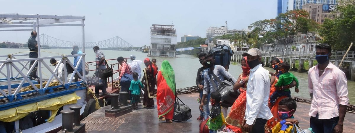 Ferry passengers being scanned for COVID-19 in Kolkata on June 2, 2020.