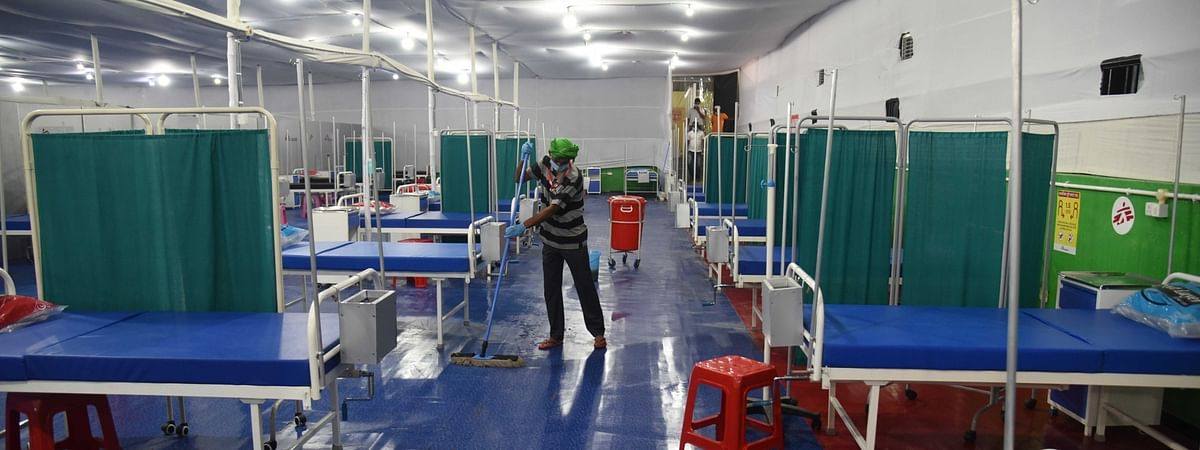 Health workers setting  up a 100-bed COVID-19 treatment centre inside Patna's Patliputra sports complex, on June 11, 2020.