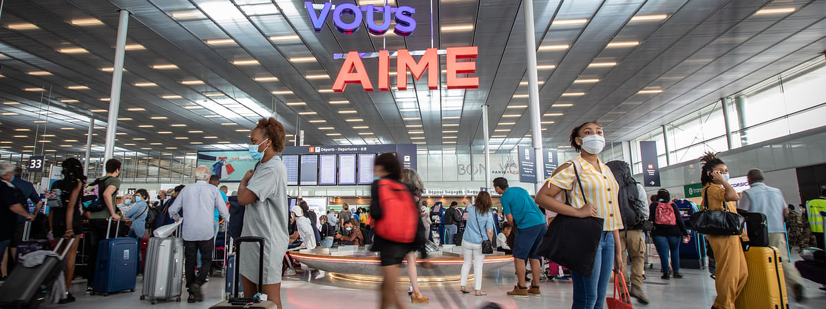 Passengers wearing face masks seen at the departure hall of Paris Orly Airport near Paris, France, on June 26, 2020.