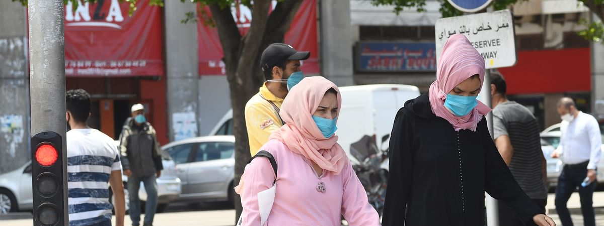 People wearing face masks are seen in Rabat, Morocco, on June 12, 2020.