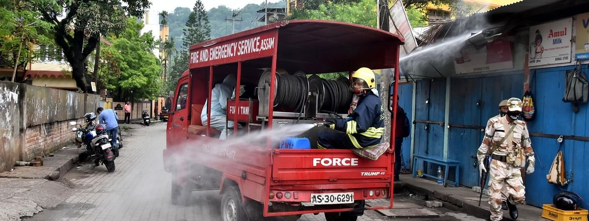 File photo of Assam State Fire and Emergency Services workers sanitising the Fancy Bazar area in Guwahati to contain the spread of coronavirus.