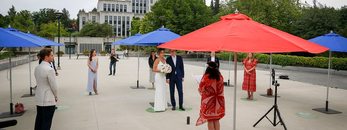 People attend an outdoor 'micro-wedding' at Helena Gutteridge Plaza in Vancouver, Canada, on June 19, 2020. It was the first round of such weddings announced in early May as an alternative for those who may have had to change their wedding plans due to the COVID-19 pandemic.