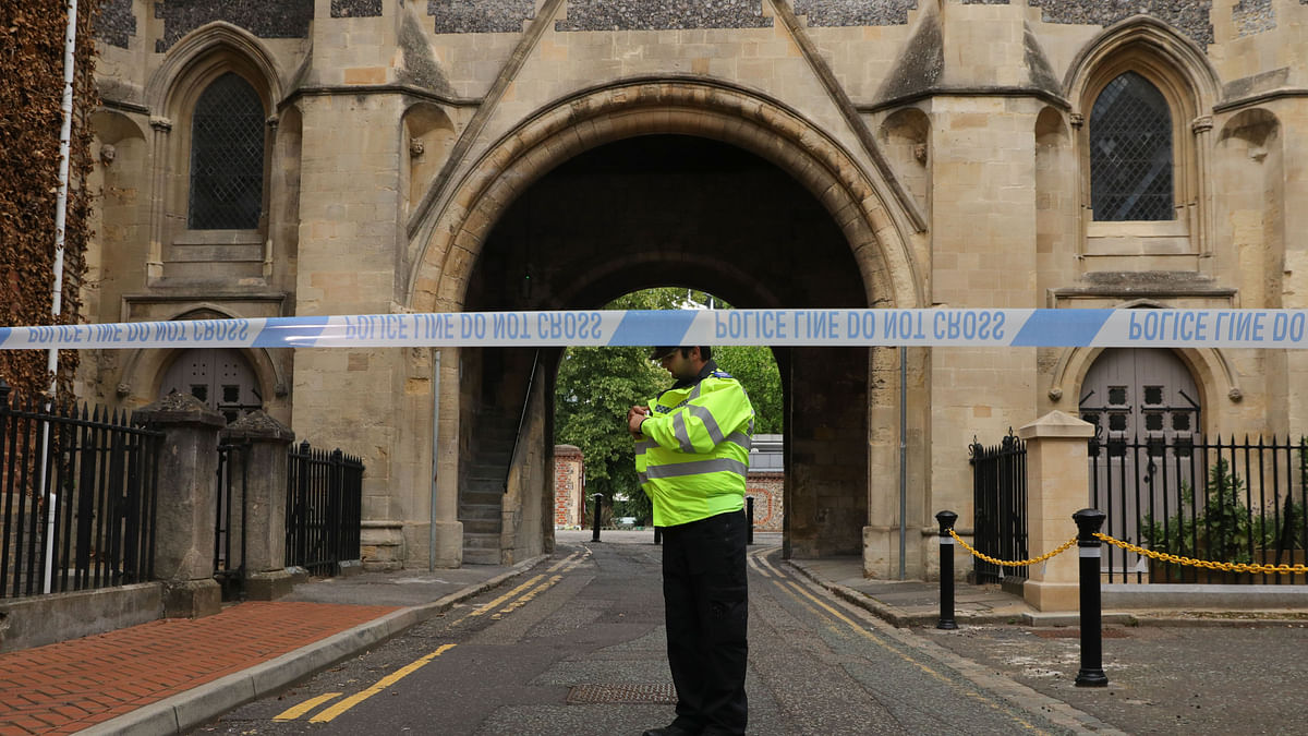 A police officer stands behind a police cordon at an entrance to Forbury Gardens where stabbings took place in Reading, Britain, on June 21, 2020.