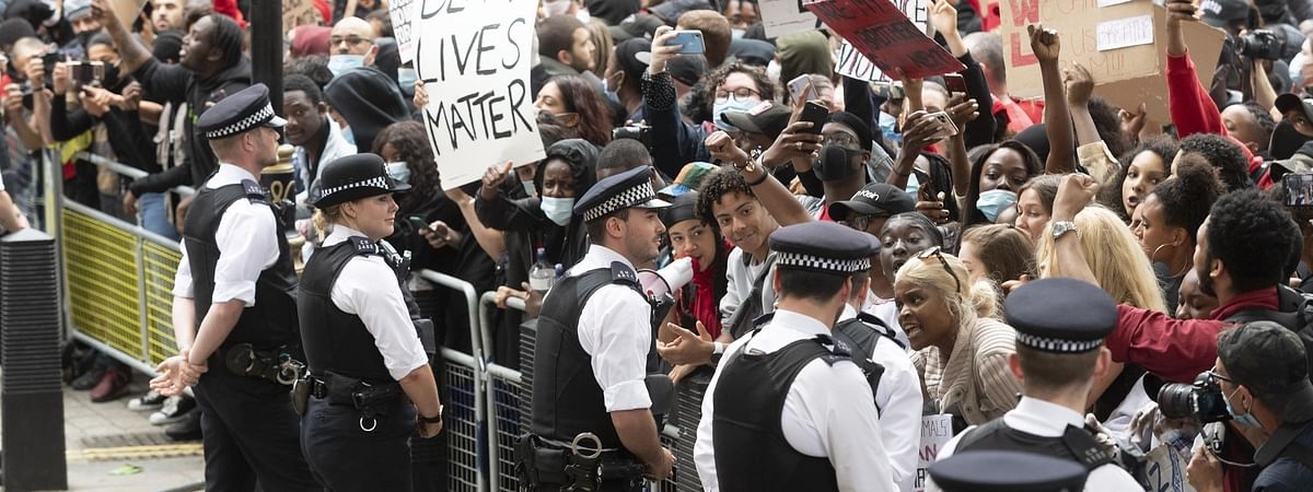 People taking part in a demonstration at Downing Street in London, Britain, on June 3, 2020, to protest over the death of George Floyd, an unarmed black man suffocated to death on May 25 by a white police officer in the mid-western U.S. state of Minnesota.