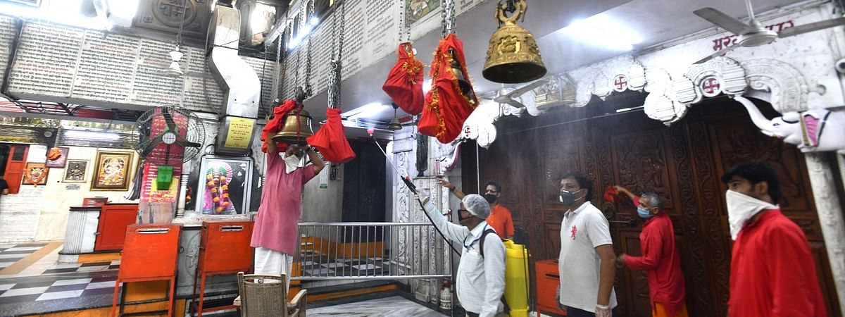Bells being covered with clothes as a precautionary measure to contain the spread of coronavirus at a Hanuman Temple ahead of the opening of religious places and places of worship across the nation from June 8; in New Delhi on June 6, 2020.