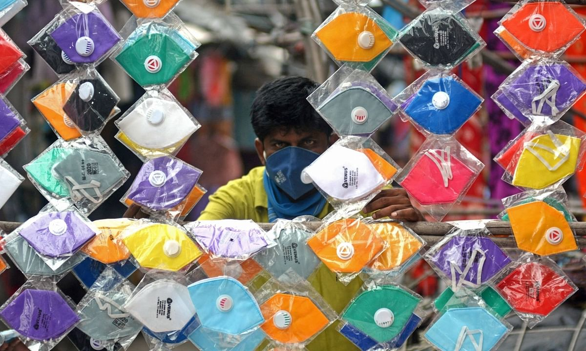 Colourful masks being sold at a streetside shop amid the phased relaxation of the nationwide lockdown imposed to mitigate the spread of coronavirus, in Kolkata on June 19, 2020.