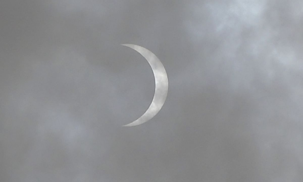 """The """"ring of fire"""" solar eclipse unfolding in the partially cloudy skies of Mathura in  Uttar Pradesh, on June 21, 2020."""