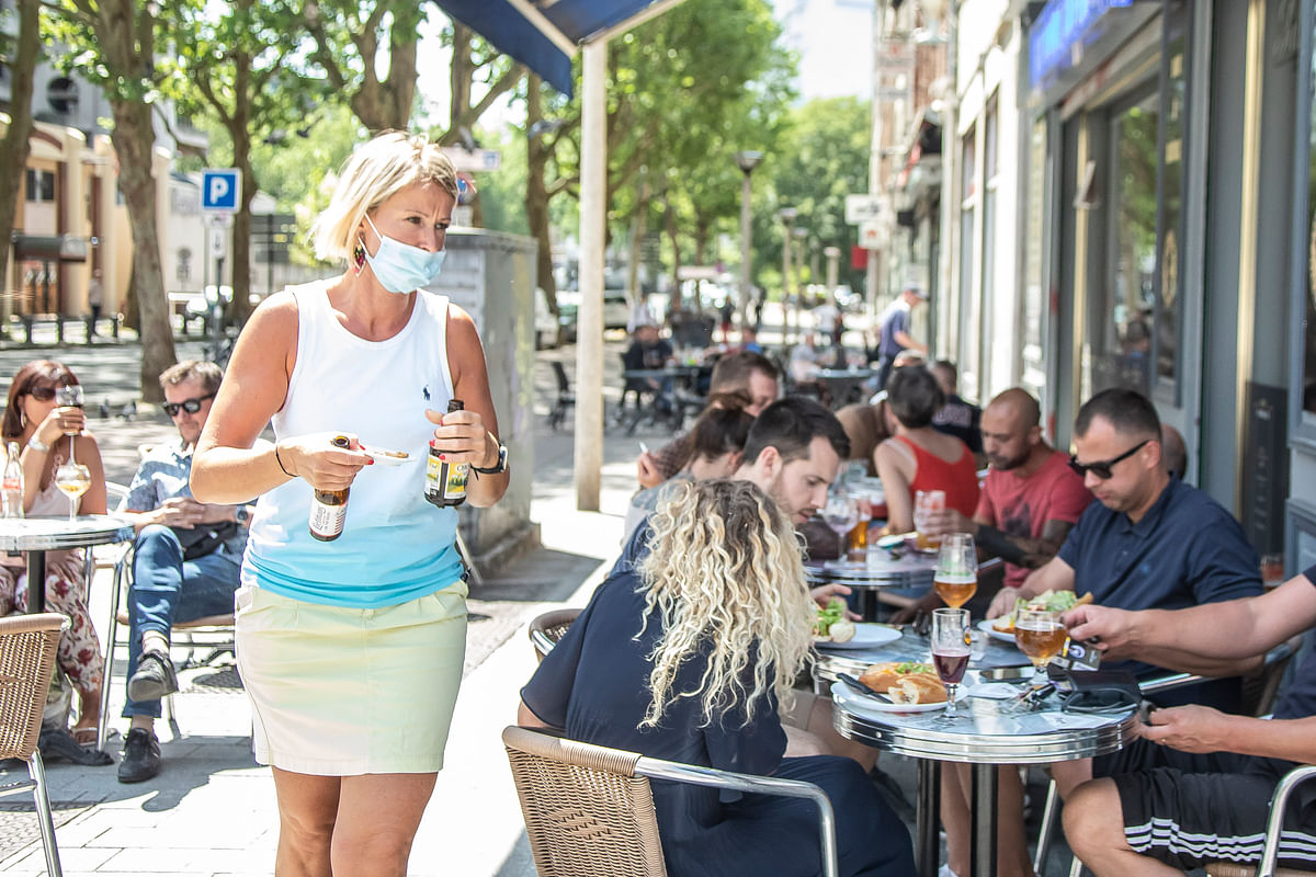 People at a restaurant in Lille, northern France on  June 2, 2020. Restaurants, bars and cafes throughout France have reopened their doors to customers with tables positioned at least one metre apart, kicking off the second phase of de-confinement in the country.
