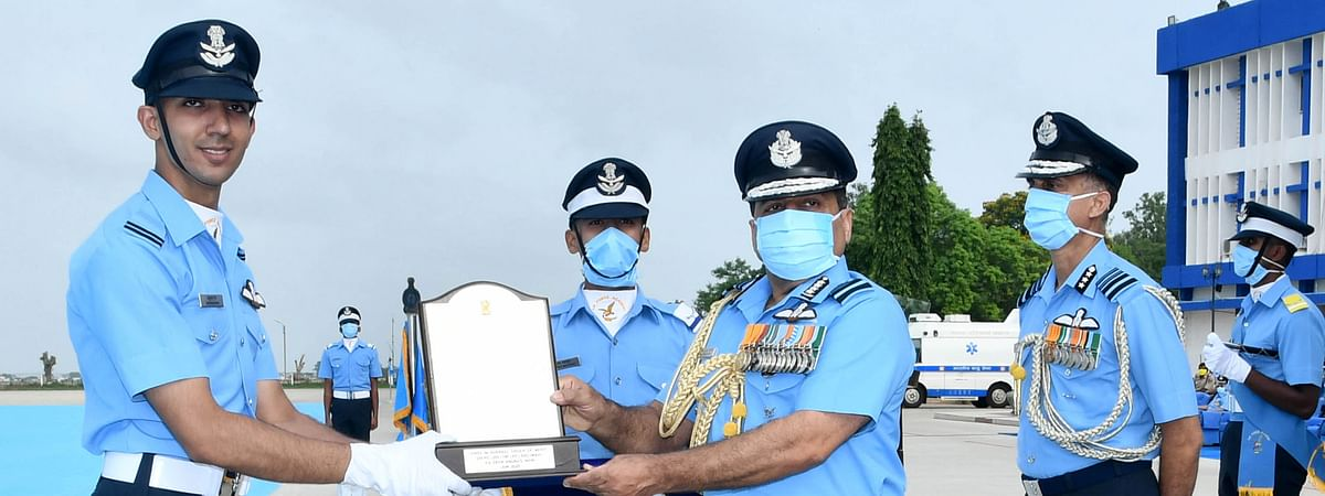 The Chief of the Air Staff, Air Chief Marshal R.K.S. Bhadauria presenting the President's Plaque to Flying Officer Anurag Nain for standing first in overall order of merit in Flying Branch, during the Combined Graduation Parade, at Air Force Academy, Dundigal near Hyderabad on June 20, 2020.
