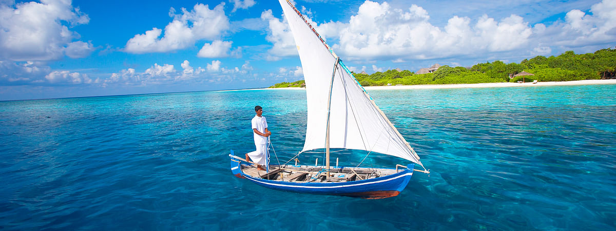 Cruising around the Maldives Islands on a traditional dhoni