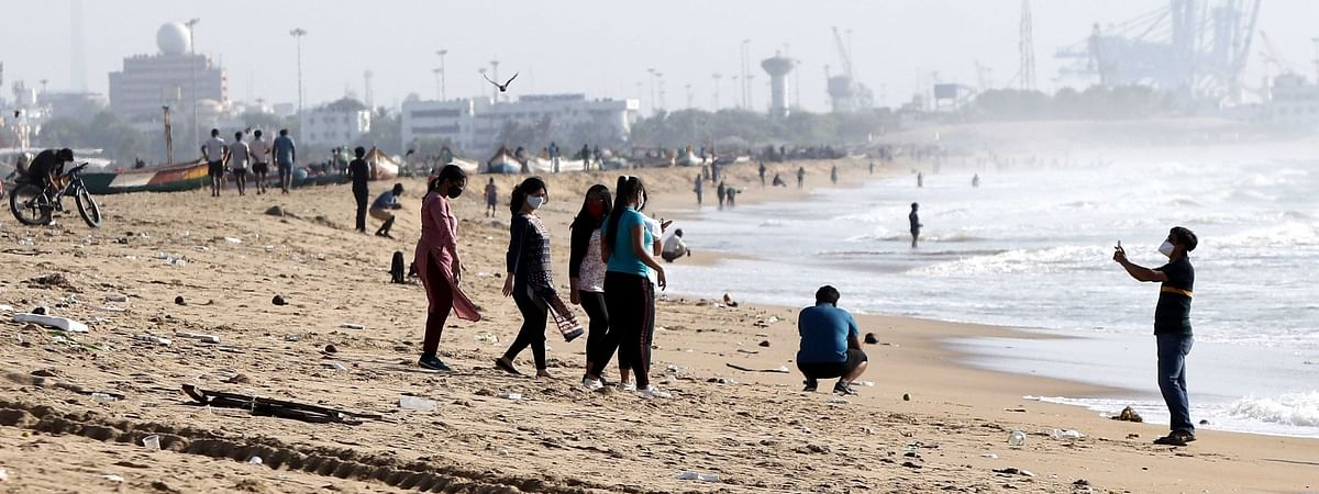 People enjoying themselves at the Marina Beach amid COVID-19 pandemic, in Chennai on July 25, 2020.