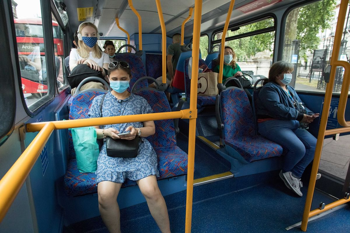People weaing face masks as they take a bus in London, Britain, on June 15, 2020.