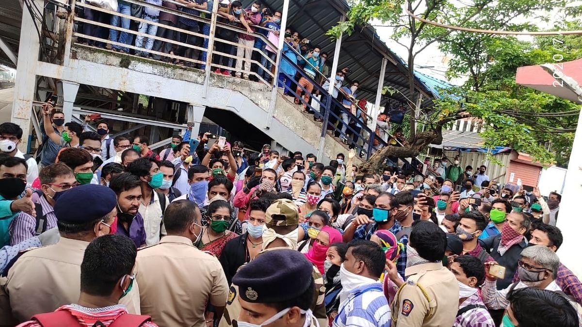 Stranded Mumbai commuters block suburban train service