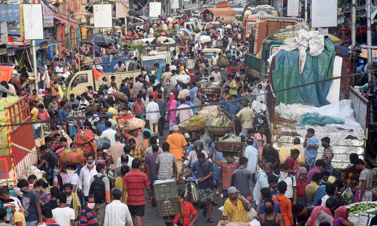Crowds seen  at a vegetable market in Kolkata during a complete lockdown imposed in all the designated COVID-19 containment zones across West Bengal, on July 26, 2020.