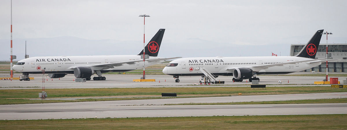 Air Canada aircraft seen at the Vancouver International Airport in Richmond, British Columbia, Canada, on July 16, 2020. There have been a total of 31 international and domestic flights in July that have been flagged by the Canadian government for possible exposure to the novel coronavirus. Passengers near the affected rows are considered close contact and may be at risk of exposure, the government said on its website.