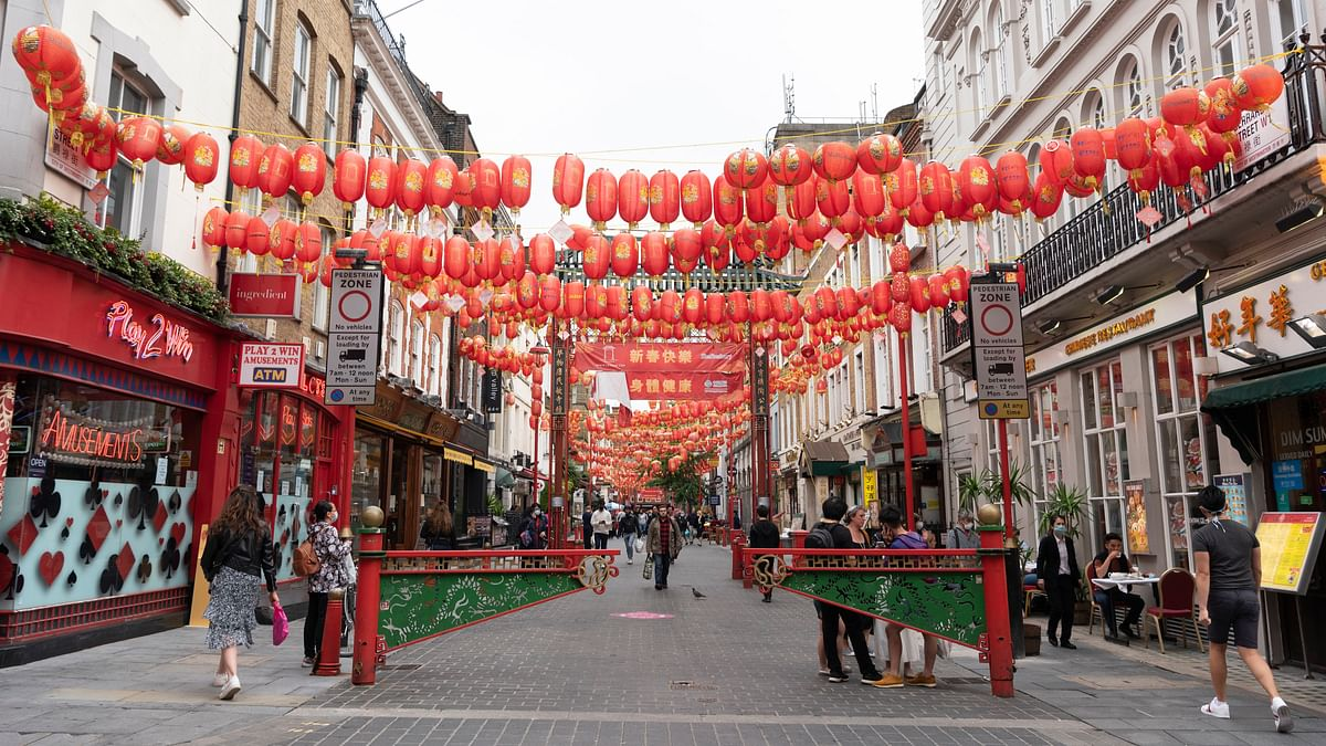 "People walking on a street at Chinatown in London, Britain, on July 4, 2020. Millions of people in England emerged from the COVID-19 lockdown on the so called ""Super Saturday"" to visit coffee shops, bars, restaurants and hair salons for the first time in over three months."