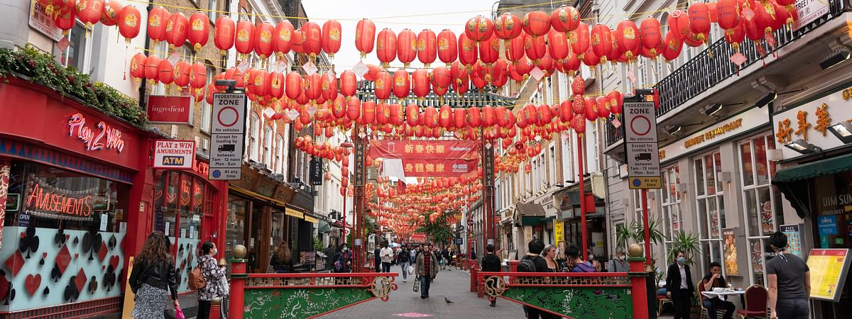 """People walking on a street at Chinatown in London, Britain, on July 4, 2020. Millions of people in England emerged from the COVID-19 lockdown on the so called """"Super Saturday"""" to visit coffee shops, bars, restaurants and hair salons for the first time in over three months."""